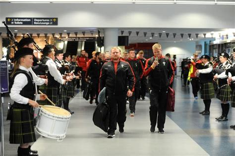 Welsh rugby team burst into song after being greeted by a