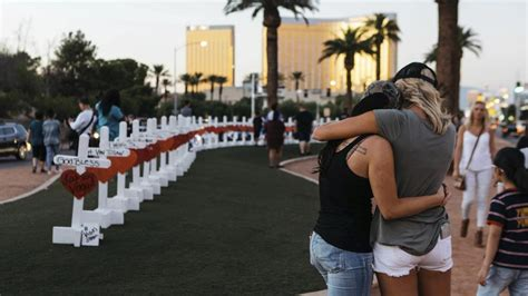 Las Vegas sign site becomes memorial to shooting victims