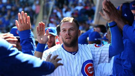 David Bote working with Cubs hitting coach Chili Davis to