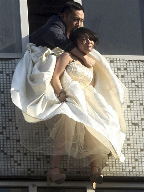 Jilted bride in China jumps out window (photos)